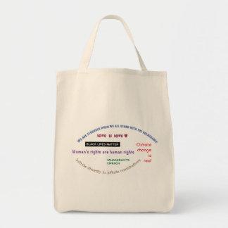 進歩的なスローガンを用いる店 トートバッグ