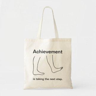 達成は次のステップのキャンバスのバッグを取っています トートバッグ