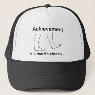 達成は次のステップの帽子を取っています キャップ