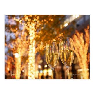 都市のクリスマスを焼くシャンペンガラス ポストカード
