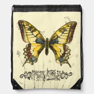 野生の花を持つ装飾的な蝶 ナップサック