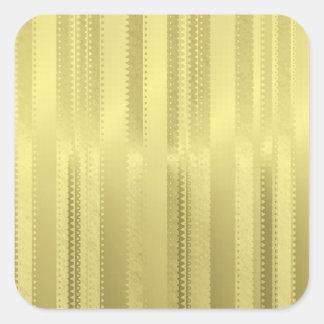 金クリスマスのリボンはホイルの紙で縞で飾ります スクエアシール