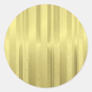 金クリスマスのリボンはホイルの紙で縞で飾ります ラウンドシール