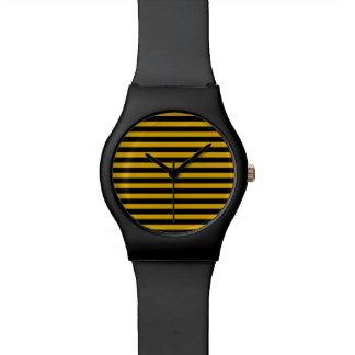 金ゴールドおよび黒のストライプの腕時計 腕時計