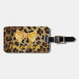 金ゴールドのきらきら光るな弓が付いているガーリーなヒョウのプリント ラゲッジタグ