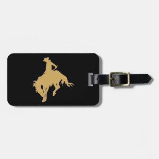 金ゴールドのカウボーイの強く反対する馬の黒 ラゲッジタグ