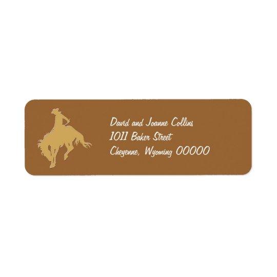 金ゴールドのカウボーイの強く反対する馬 ラベル
