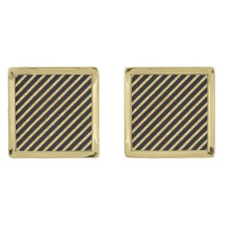 金ゴールドのグリッターおよび黒い対角線のストライプなパターン ゴールド カフスボタン