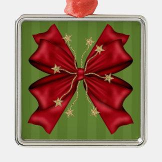 金ゴールドの星が付いている赤いクリスマスの弓 メタルオーナメント
