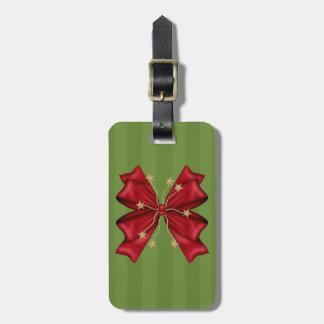 金ゴールドの星が付いている赤いクリスマスの弓 ラゲッジタグ