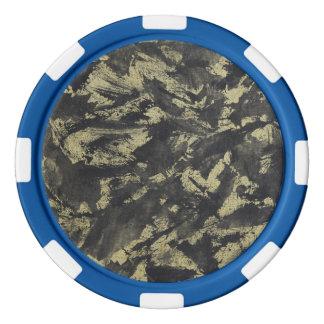 金ゴールドの背景の黒いインク ポーカーチップ
