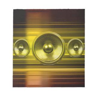 金ゴールドの軽い縞が付いている音楽スピーカー ノートパッド