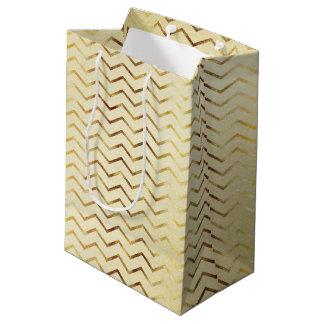 金ゴールドの金ゴールドのきらめくシェブロン ミディアムペーパーバッグ