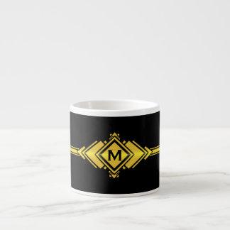 金ゴールド及び黒いアールデコベルトのモノグラム エスプレッソカップ