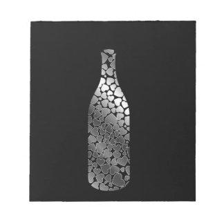 銀製のハートが付いているボトル ノートパッド
