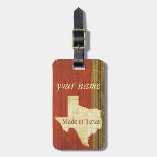 錆ついた赤い黙したストライプのテキサス州の荷物のラベル ラゲッジタグ