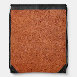 錆によって着色されるスタッコ ナップサック