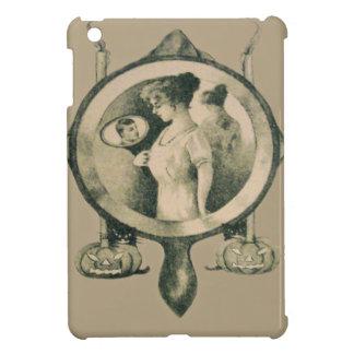 鏡の女性はジャックOのランタンの黒猫の良否を明りにすかして調べます iPad MINIケース