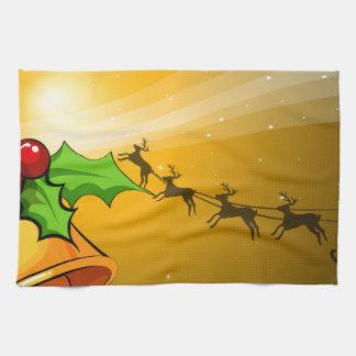 鐘が付いているクリスマスカードおよび手綱が付いているそり キッチンタオル