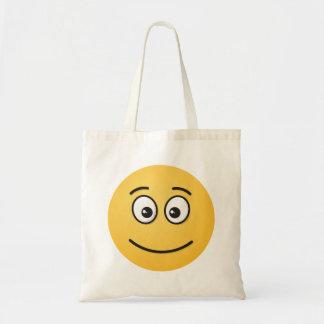 開いた目が付いている微笑の顔 トートバッグ