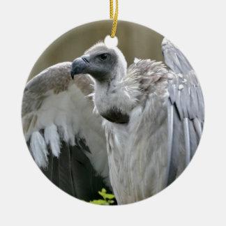 開いた翼を持つ白に支えられるハゲタカ セラミックオーナメント