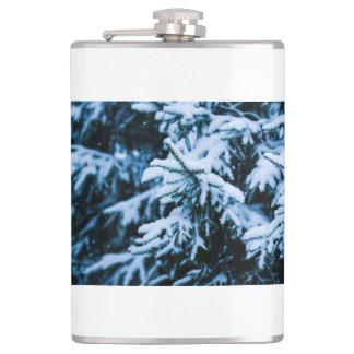 降雪の冬のクリスマスツリー フラスク