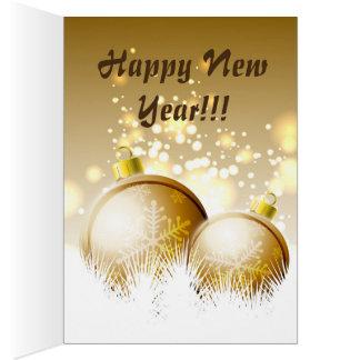 雪が付いている金茶色の新年の装飾 カード
