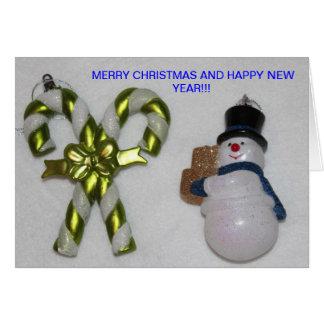 雪だるまおよび緑のキャンディ・ケーンのクリスマスカード カード