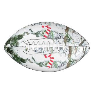 雪で覆われた木のキャンディ・ケーンの装飾 アメリカンフットボール