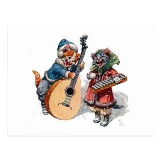 雪のかわいい猫の演劇のマンドリンそして木琴 ポストカード
