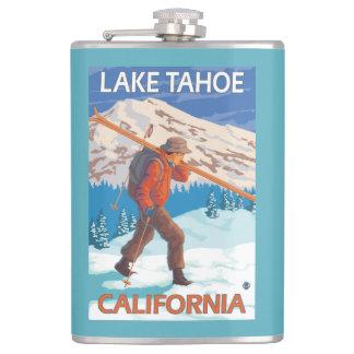 雪のスキー-タホ湖、Californi --を運んでいるスキーヤー フラスク