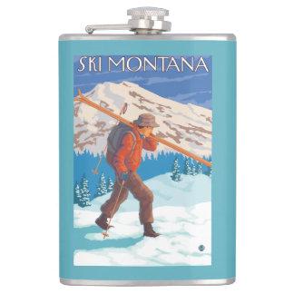 雪のスキー-モンタナ--を運んでいるスキーヤー フラスク