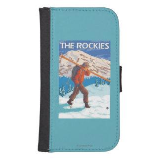 雪のスキー-ロッキー山脈--を運んでいるスキーヤー ウォレットケース