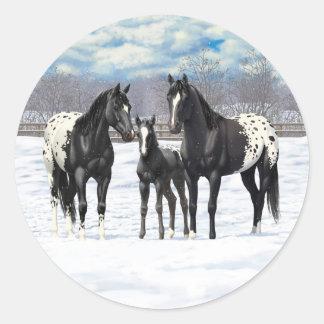 雪の黒いAppaloosaの馬 ラウンドシール