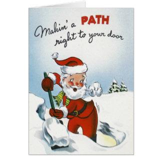 雪をシャベルで掘っているヴィンテージサンタ カード
