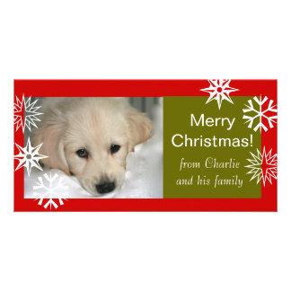 雪片はメリークリスマスの写真カードの後をつけます カード