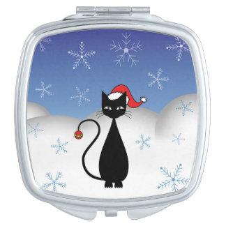 雪片を持つクリスマス猫