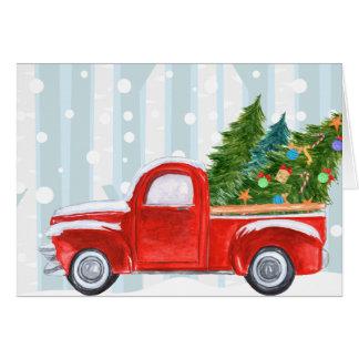 雪道のクリスマスの赤い小型トラック カード