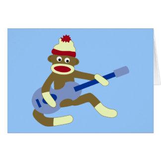 青いギターを演奏しているソックス猿 グリーティングカード