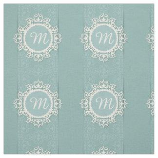 青いダマスク織の背景の白い花フレーム ファブリック