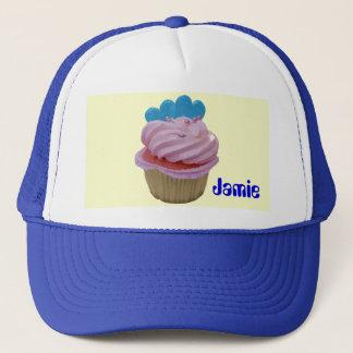 青いハートが付いているピンクのカップケーキ キャップ