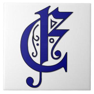 青いモノグラムのタイルのColchesterの手紙E タイル