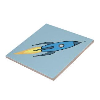 青いレトロのRocketshipのかわいい漫画のデザイン タイル