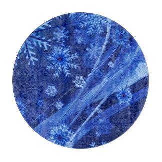 青い冬の雪片のクリスマス カッティングボード