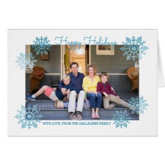 青い揺らめくシックな雪片の休日の写真 カード