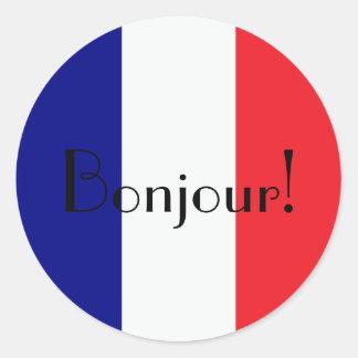 青い白くのフランスのな旗とのBonjourおよび赤い ラウンドシール