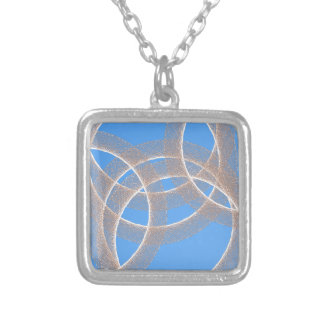 青い背景の抽象芸術の軽いリングや輪 シルバープレートネックレス