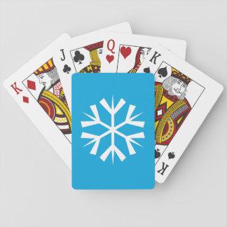 青い背景の白い雪片の記号 トランプ