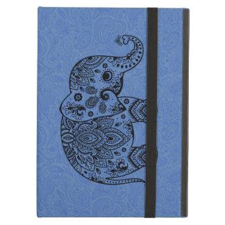 青い背景の黒い花のペイズリー象