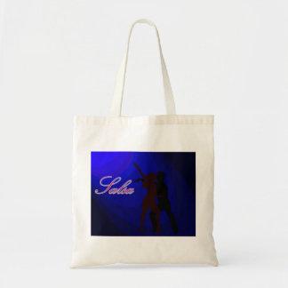 青い背景を持つサルサのダンサーのシルエット トートバッグ